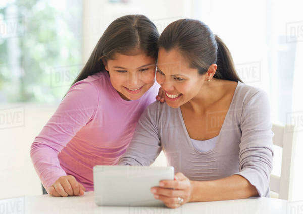Mother and daughter (10-11) using digital tablet Royalty-free stock photo