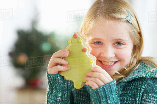 Girl (8--9) holding gingerbread cookie Royalty-free stock photo