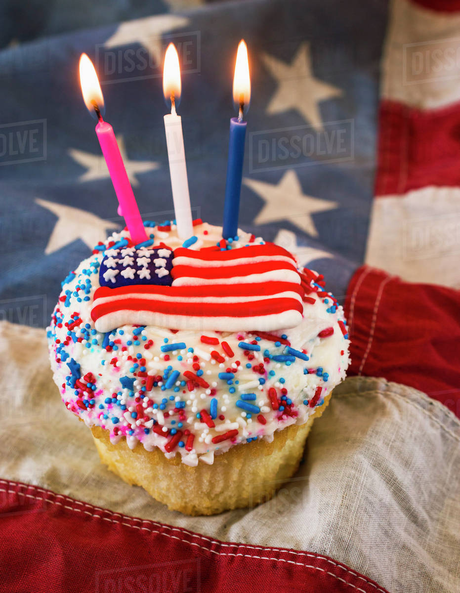Birthday cake with American flag - Stock Photo - Dissolve