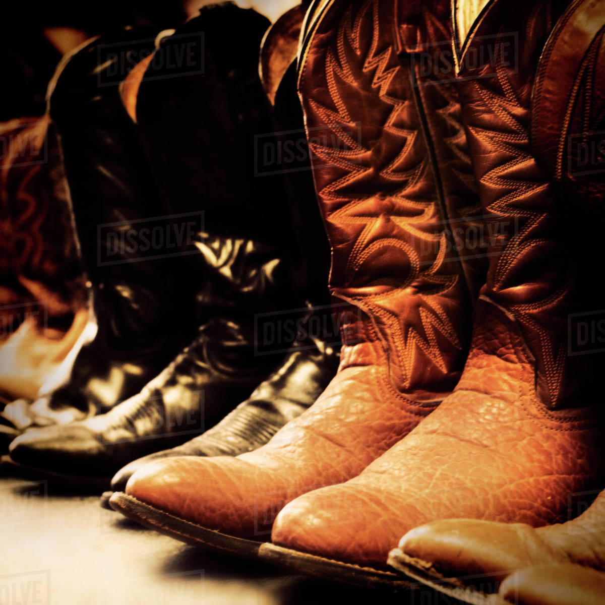 92525c1cba8 Row of cowboy boots - Stock Photo - Dissolve