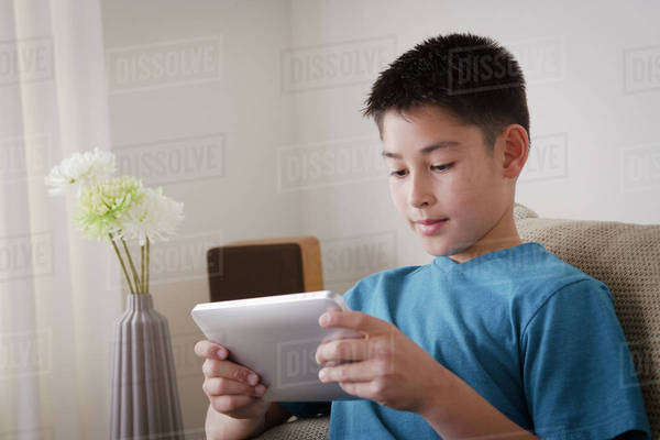 Boy (10-11) using digital tablet Royalty-free stock photo