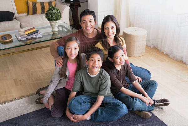 Portrait of family with three children (8-9, 10-11) Royalty-free stock photo