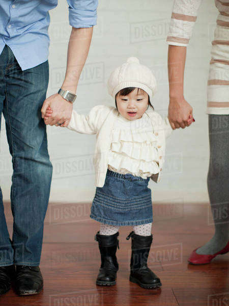 Young parents with baby girl (12-17 months) Royalty-free stock photo