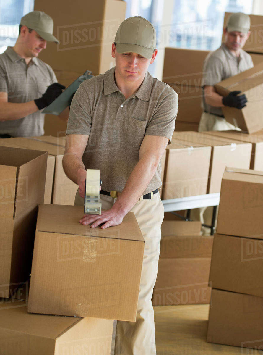 usa new jersey jersey city men packing boxes in warehouse stock