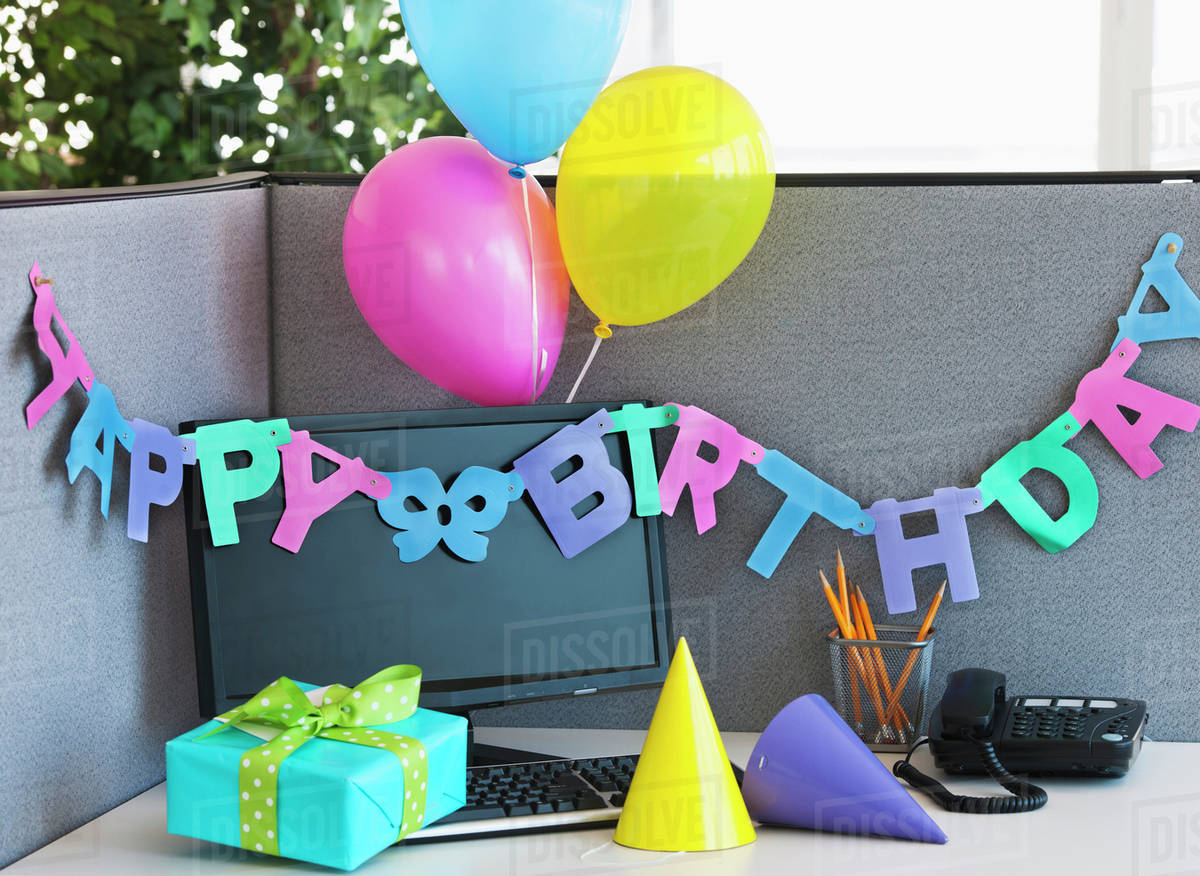 Close Up Of Birthday Decorations On Office Desk