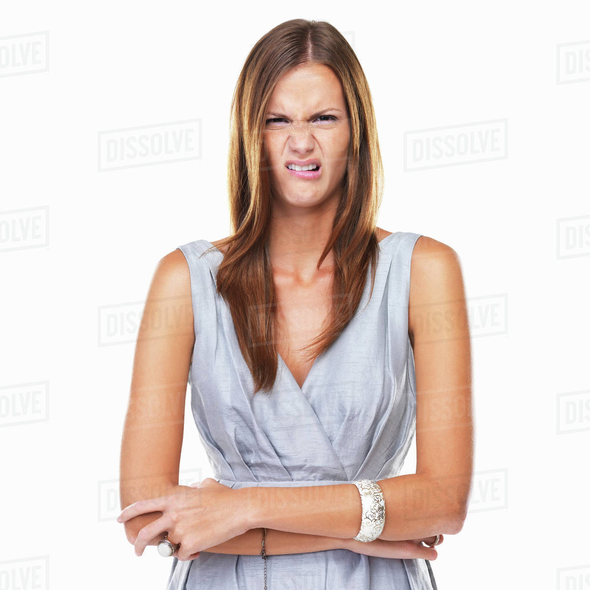 Studio portrait of elegant woman with disgusted expression Royalty-free stock photo