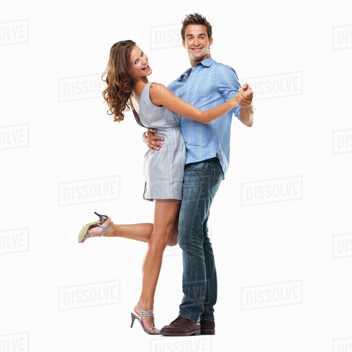 Studio Shot Of Young Couple Dancing Together And Smiling Stock Photo Dissolve