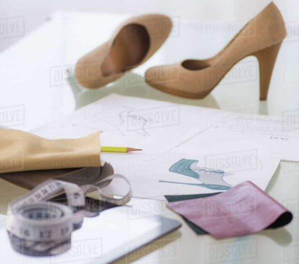 Studio Shot of sketch, tape measure and shoes Royalty-free stock photo