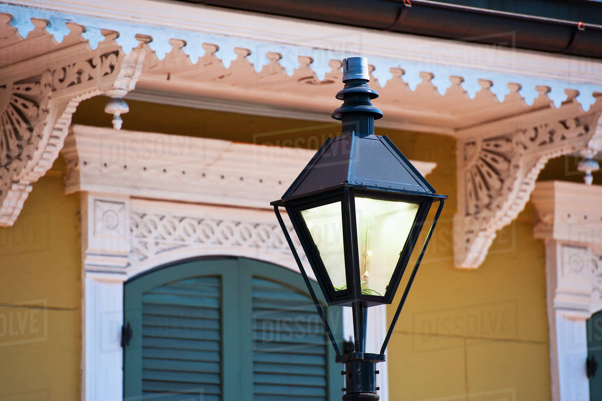 Lamp Post In Front Of House In French Quarter Of New Orleans Stock Photo