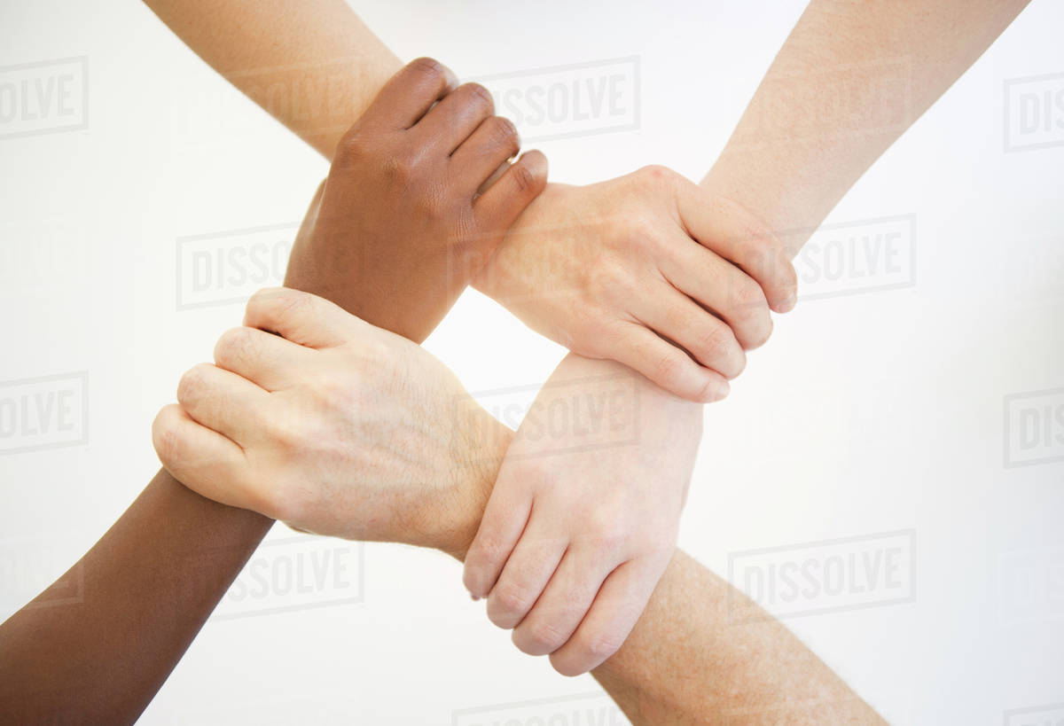 Four hands holding wrists of other people - Stock Photo ...