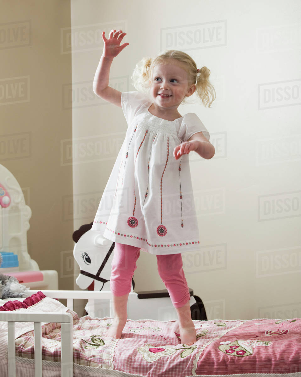c806f252b16a Young girl dancing on her bed - Stock Photo - Dissolve