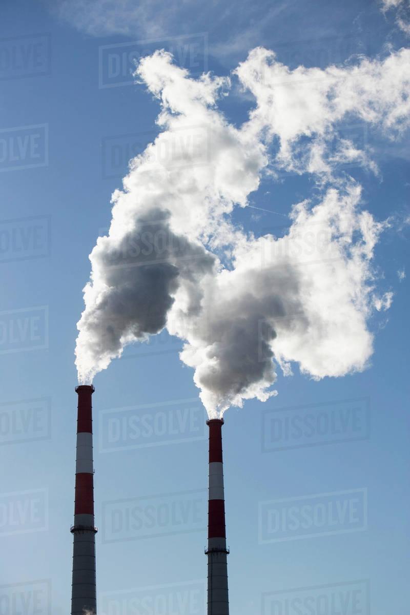 Smoke emitting from smoke stacks Royalty-free stock photo
