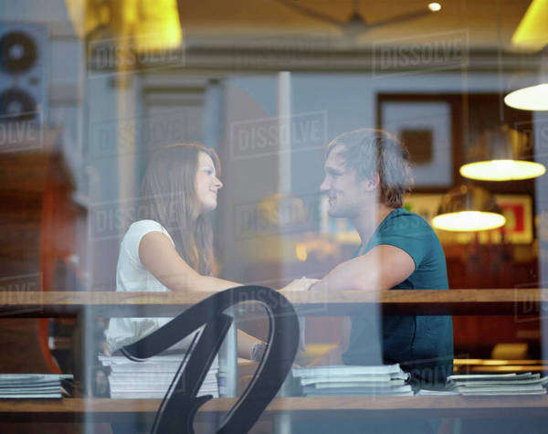 Portrait of couple talking in coffee shop Royalty-free stock photo