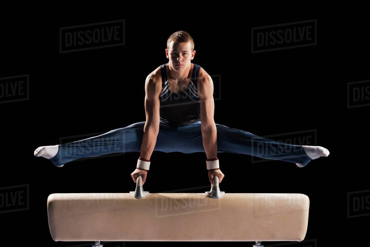 gymnast on pommel horse stock photo dissolve