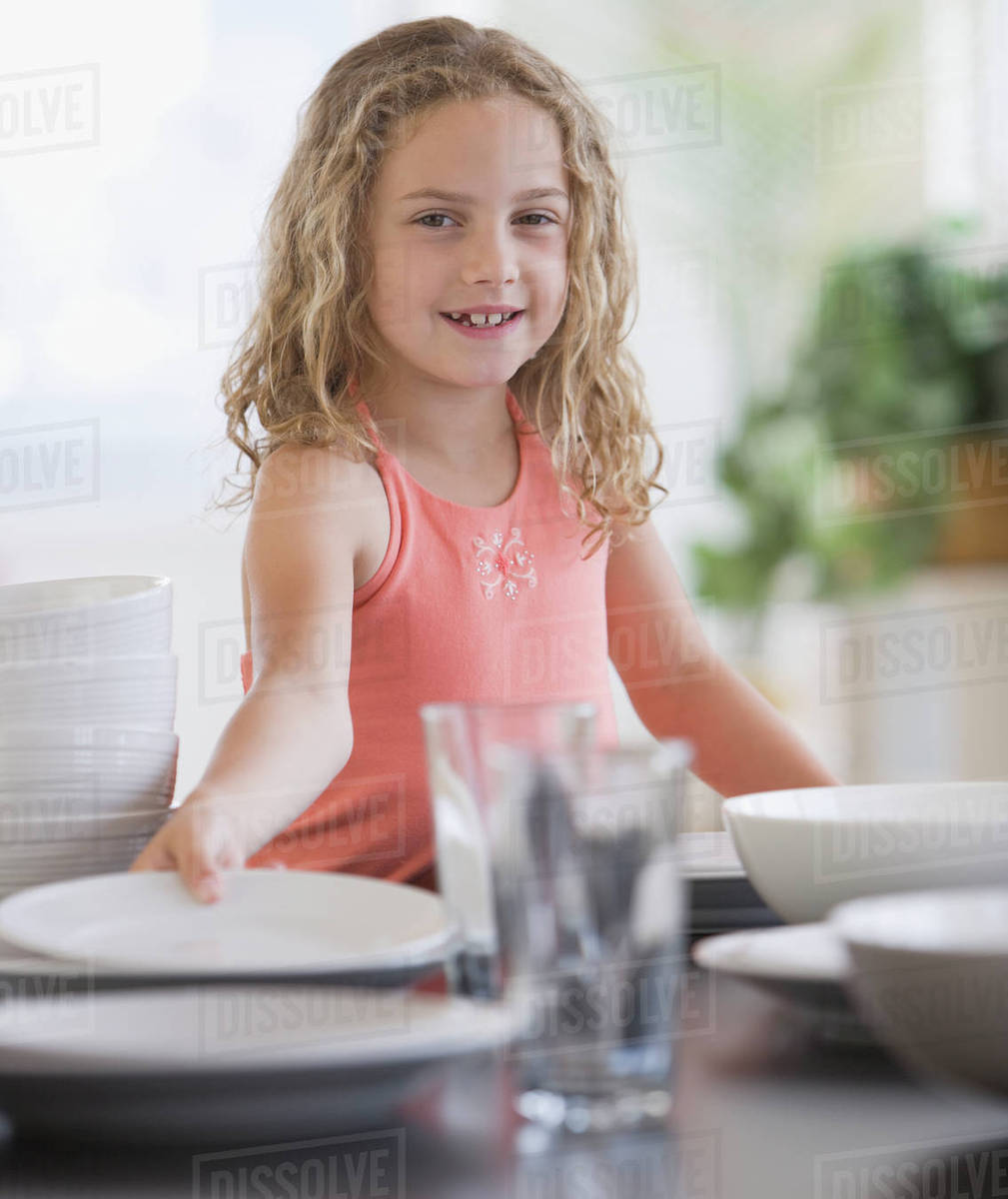 Girl Setting Table Stock Photo Dissolve