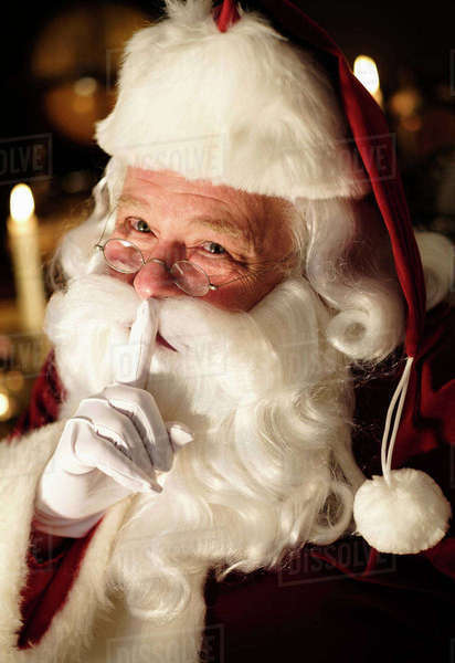 Portrait of Santa Claus with finger on lips Royalty-free stock photo