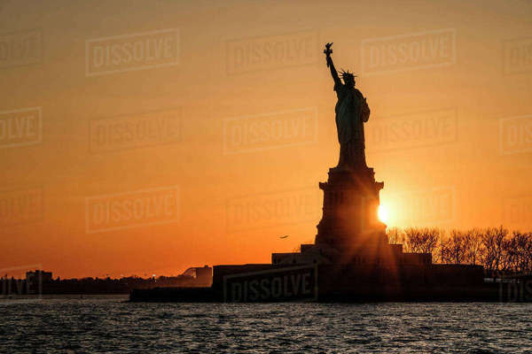 Silhouette of Statue of Liberty at sunset Royalty-free stock photo