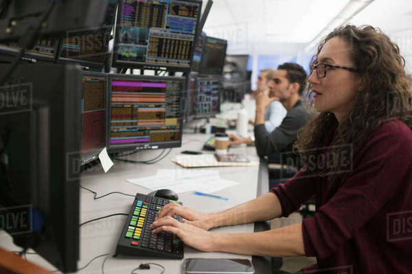 Young traders analyzing computer data Royalty-free stock photo