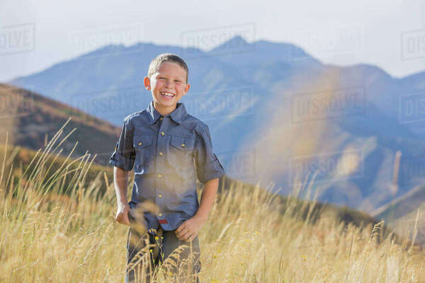 USA, Utah, Provo, Boy (6-7) standing in field Royalty-free stock photo