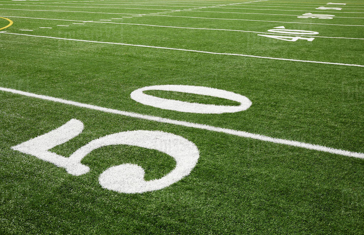 Football Field Marking Of 50 Yard Line Stock Photo Dissolve