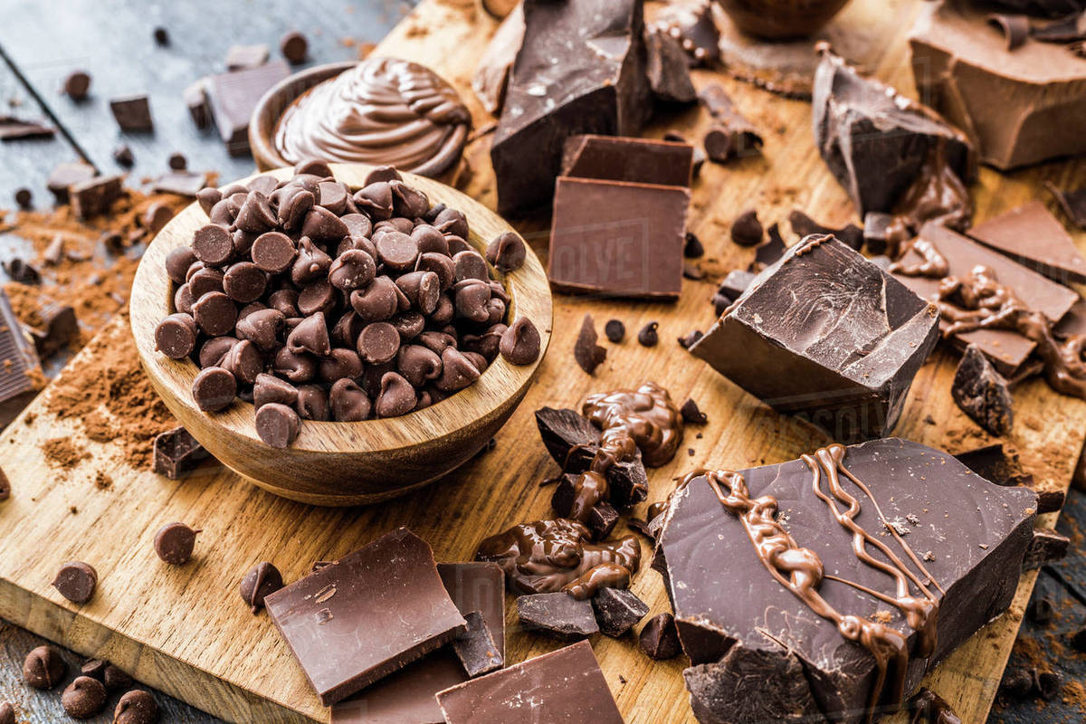 Various chocolate pieces on cutting board Royalty-free stock photo