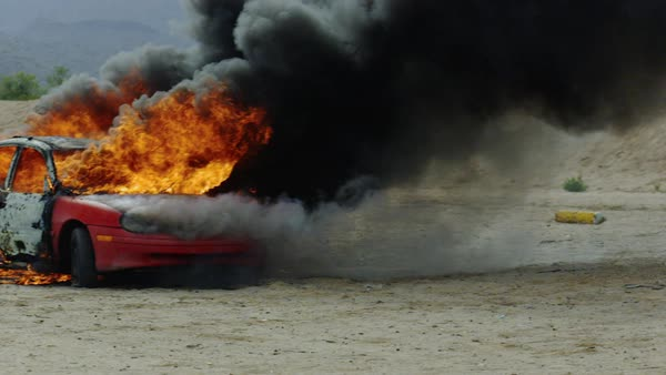 Pan around a red car on fire. Royalty-free stock video