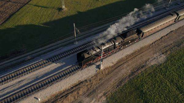 Aerial - Steam engine train crossing the river Royalty-free stock video