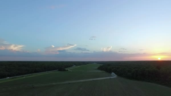 Aerial sunset over crop field Royalty-free stock video