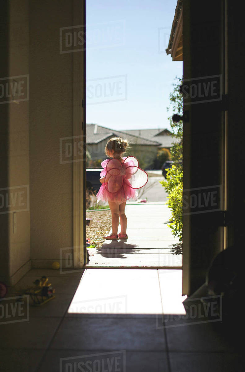 Girl wearing fairy costume seen from doorway Royalty-free stock photo