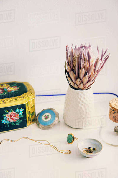 High angle view of box and jewelry by flower vase on table Royalty-free stock photo