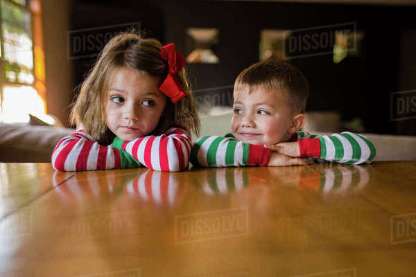 Siblings leaning on table at home Royalty-free stock photo