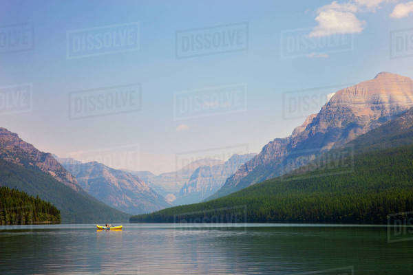 Woman in canoe floating on lake Royalty-free stock photo