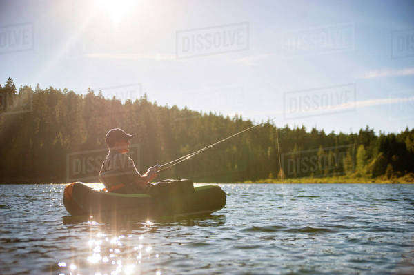 Man fishing in middle of lake Royalty-free stock photo