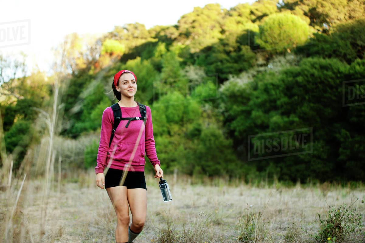 Woman hiking through field Royalty-free stock photo