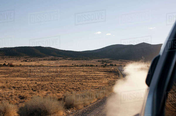 Smoke emitting from car on country road Royalty-free stock photo