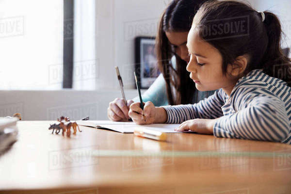 Girls studying while sitting at table Royalty-free stock photo