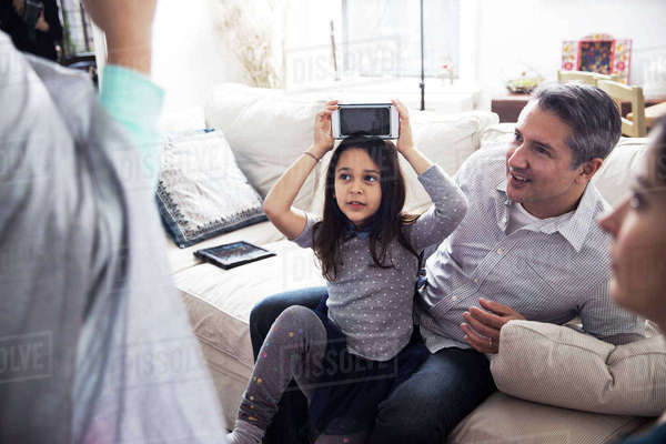 Parents looking at girls playing heads up game Royalty-free stock photo