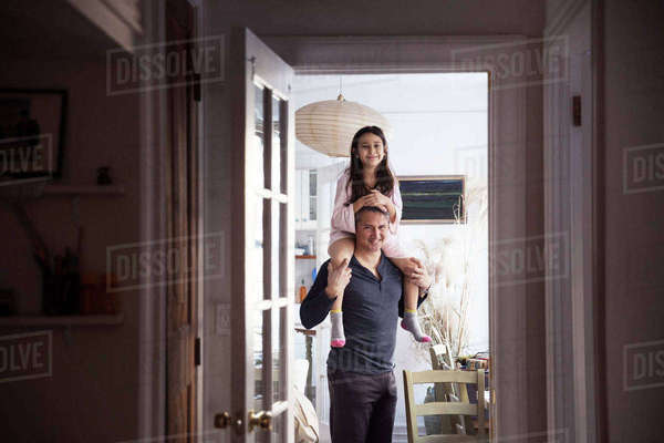 Portrait of father and daughter standing at home Royalty-free stock photo