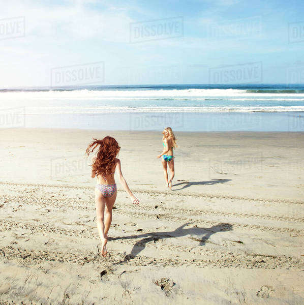 Female friends running on beach Royalty-free stock photo