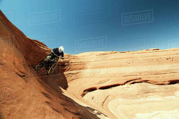 Mountain biker riding downhill Royalty-free stock photo