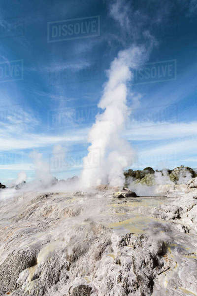 Smoke emitting through Pohutu geyser against sky at Whakarewarewa Thermal Park Royalty-free stock photo