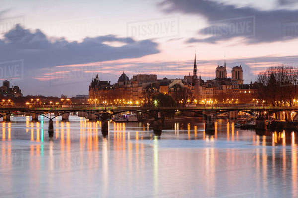 Bridge over Seine River against sky during sunset in city Royalty-free stock photo
