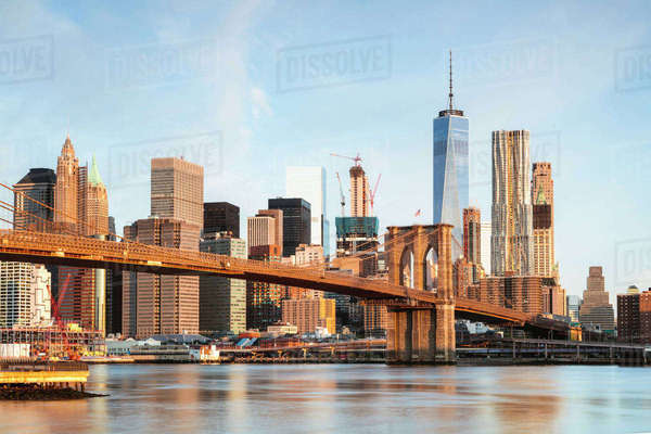 Brooklyn Bridge over East river against sky in New York city Royalty-free stock photo
