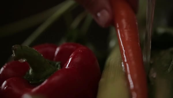 Close-up of vegetables being washed under running water Royalty-free stock video