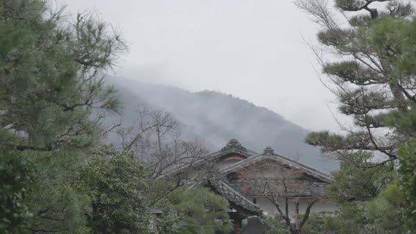 Low angle view of traditional building by mountain in foggy weather Royalty-free stock video
