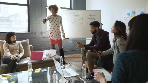 Dolly shot of colleagues discussing in board room Royalty-free stock video