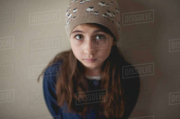 Portrait of girl standing against wall at home Royalty-free stock photo