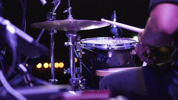 Dolly shot of drummer playing drum set during concert night Royalty-free stock video