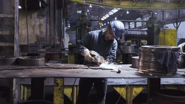 Handheld shot of worker welding at table in workshop Royalty-free stock video