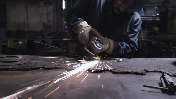 Handheld shot of worker welding metal in workshop Royalty-free stock video